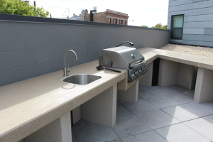 Outdoor grilling area.  Concrete counter top with