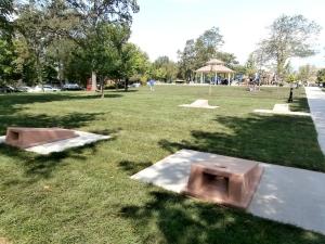 Concrete cornhole boards shown at a park in Winnetka, IL